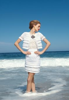 This is such a beautiful (and impractical suit) <3 OSCAR DE LA RENTA  Hand-knit counterpane crochet short-sleeve jacket and slim skirt in white cotton/nylon with lace and fringe detail. Imported. Jacket $1,490. Skirt $1,890. Sleeveless tank in white graphic floral polyester lace. Also available in black. USA. $650.