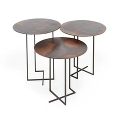 """• Small: 18""""h x 20""""d • Medium: 20""""h x 20""""d • Large: 22""""h x 20""""d • Metal • Made in ItalyAncestral elements like lava and metal are reinvented in this modern design. Set on an architectural, hand-welded metal frame, each tabletop features a unique patina. Handcrafted in Italy, this one-of-a-kind piece exists at the apotheosis of design, industry, and craftsmanship."""