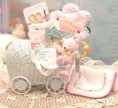 Send them our Bundle of Joy Baby Gift Basket   and that special family will feel overwhelmed with love with their new bundle of joy and gift basket.  This lovely white wicker baby carriage is filled with cute little goodies and gifts for the new baby.  Available in pink or blue and teal, this is the perfect baby gift basket to send.  $49.99  http://www.littlegiftbasketboutique.com/item_455/Bundle-of-Joy.htm