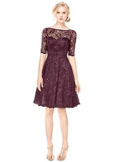 Ultra-feminine and chic, this lovely lace bridesmaids dresswill be astaple in your wardrobe forseasons to come!  Contrast corded lace dress features illusion neckline and elbow length sleeves.  V-cut open back.  Full a-line skirt.  Fully lined. Back zip. Imported polyester. Dry clean only.