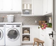 Love the greige subway tile backsplash and off-white cabinets in this laundry room. Tiffany Harris Design creates spaces of crisp white, rustic textures, lux materials, and modern lines that feel on-trend yet unique and timeless. Laundry Bin, Laundry Room Storage, Doing Laundry, Laundry Room Design, Laundry Cabinets, Kitchen Cabinets, Garage Cabinets, Island Kitchen, Kitchen Tiles