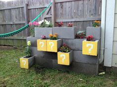 Amazing! Cinder block planter to hide AC unit, painted to look like Mario cubes