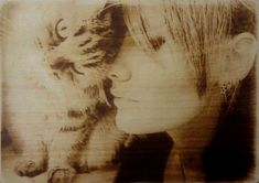 #Pyrography by me Watch more artworks: http://pyroprint.com/pyrography-by-me/  Girl with her cat Style of wood burning - natural portraits