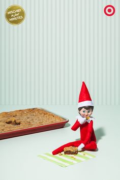 Meet the Elf On The Shelf: International Man Of Mischief. How do we know he's mischievous? With this one simple test: 1 - Leave a fresh-baked pan of holiday treats out on the counter overnight. 2 - When you wake up, check to see if that Elf has snuck onto the counter, and cut one for himself RIGHT FROM THE DELICIOUS CENTER OF THE PAN.