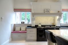 Lewis Alderson & Co, Barnt Green Kitchen. Our trademark hand-made chimney breast beautifully frames the AGA with a cosy window seat positioned to one side. Aga Kitchen, Kitchen Units, Green Kitchen, Kitchen Cabinets, Fireplace Design, Fireplace Ideas, Chimney Breast, Open Plan Living, Kitchen Remodel