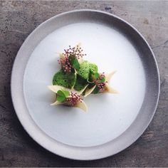 Apple and fennel dumplings, foamed wood sorrel, and black lace elderflower by @adelasterfoodtextures #TheArtOfPlating
