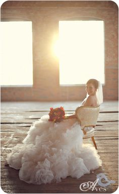 Bridal Pictures in a vintage chair inside an old rustic building. Wedding vintage goodness.