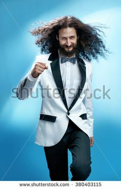 Funny and siknny man wearing tuxedo - stock photo