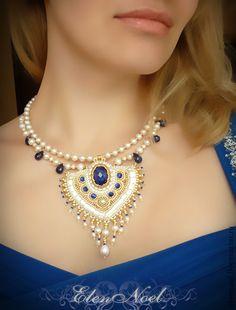 54810633485-ukrasheniya-kole-blue-sapphire-n5671.jpg 422×555 pixels