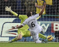Swansea 2-1 Arsenal: Arsenal's Polish goalkeeper Woijech Szczelny saves a point blank goal attempt from Ashley Williams.
