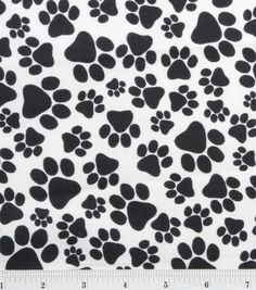 Joanne's Fabrics has lots of craft supplies....   Snuggle Flannel Fabric-Paws Black,