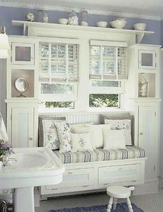 Nice bench - love the shelf over the window & the shelves on the side. Just not in the bathroom but for Logan's room.