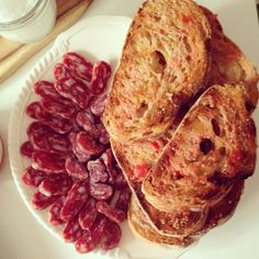 Pa amb tomata & fuet, which you can get here: http://catalanfoodandwine.co.uk/condiments/catalan-charcuterie/fuet.html
