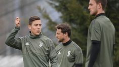 Paulo Dybala & Claudio Marchisio (Juventus) Paulo Dybala and Claudio Marchisio (C) of Juventus take part in a training session ahead of their UEFA Champions League quarter-final first leg against Real Madrid