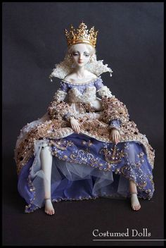 I love Marina Bychkova's dolls.  She does everything from making the dolls, the clothing, the shoes, the jewelry and all the details that go into everything.  This IS my grail doll and sadly I can't afford it.  Her dolls go for thousands of dollars.  Am hoping to get a resin one one day.