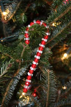 Christmas Crafts : Illustration Description Candy cane beaded ornament for Christmas tree Christmas Ornaments To Make, Christmas Crafts For Kids, Homemade Christmas, Holiday Crafts, Christmas Diy, Christmas Decorations, Candy Cane Crafts, Candy Cane Ornament, Ornament Tree