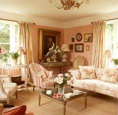 .Love this room.... cozy and feminine!
