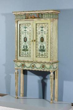 CREATOR(S)Robert Adam  Antonio Zucchi  TITLEBookcase  DATE1776  MEDIUMpainted mahogany, gilded bronze, and brass