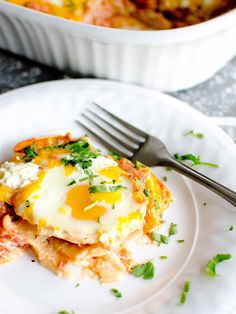 Breakfast or dinner? These cheesy baked eggs serve well at every meal. Layers of corn tortillas, tomato cream sauce, eggs and cheese. Make it today.