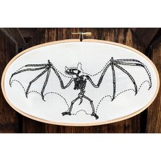 Hand embroidered bat skelton in oval hoop, macabre halloween embroidery, animal anatomy art
