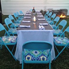 Spray painted metal folding chairs with oil cloth seat covering // made for a fun party and were inexpensive, easy to make and store