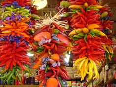 Hanging Multi-colored Pepper Ristras in Seattle at the Pike Place Farmers Market in Post Alley