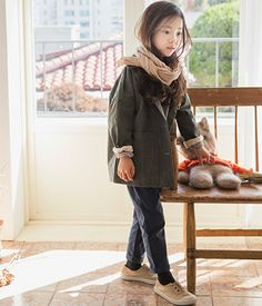 TheJany Button-Down Pocket CoatGet your child ready for the chill ofautumn and winter with this coat that comes with spread collar, long sleeves, pockets, mid thigh hemline and button-down closure. Partner this with sleeved top beneath and skinny pants.