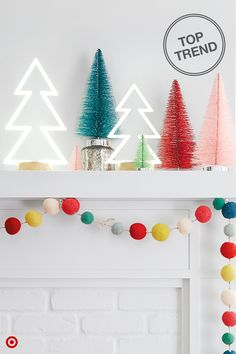 Who says you need to decorate for Christmas in classic reds and greens? Break tradition and decorate your mantle in bright, bold colors and unexpected decor pieces. Mix colors combos, textures and finishes to create a look that's uniquely you. Playful pom pom garland, metallic bottle brush trees and fun neon light trees help bring on modern merriment. Go all out!