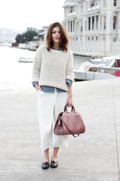 White midi skirt, sweater over a chambray shirt, loafers.