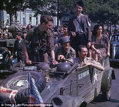 French liberation parade, WWII.  I love the dress on the woman at the back of the jeep!