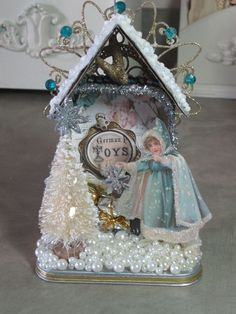 Mixed media Christmas diorama, looks like an altered altoid tin. Has an elegant wintry appeal. Christmas Past, Pink Christmas, Christmas Projects, All Things Christmas, Christmas Holidays, Christmas Decorations, Christmas Ornaments, Christmas Houses, Beautiful Christmas