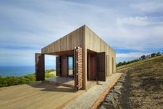 This compact coastal cabin sits in the ocean's edge in Victoria, Australia. The open design allows residents to feel connected to the surrounding landscape, whilst the small internal space encourages a minimal way of living intended to further the relationship with the outside space. Photography: Jeremy Weihrauch-Gollings Studio