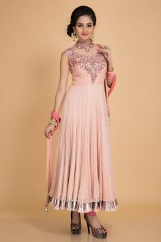 Adorn this subtle #chiffon peach #anarkali accentuated with #resham and #silver #embroidery on the yoke.