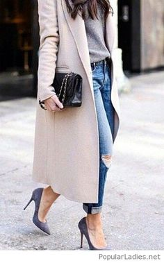 Blue jeans, grey sweater and high heels with a long nude coat