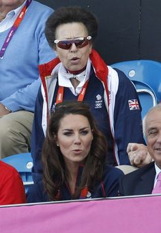 Catherine, Duchess of Cambridge, and Princess Anne (top) react as they watch the men's Group A preliminary round field hockey match between Britain and Pakistan at the Riverbank Arena during the London 2012 Olympic Games August 3, 2012.