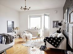 Back to beautiful basics - monochrome and brass in a Swedish space