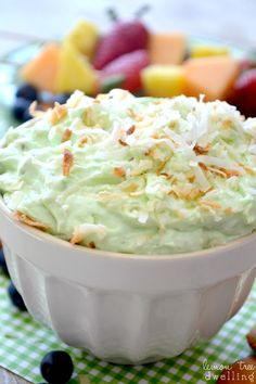 Pistachio Pineapple Dip: Ingredients  .        1 (8 oz.) package cream cheese,     1 c. crushed pineapple with juice,     ½ c. Greek vanilla yogurt,     1 (3 oz.) package pistachio pudding,     ¼ c. toasted coconut, plus more to sprinkle on top