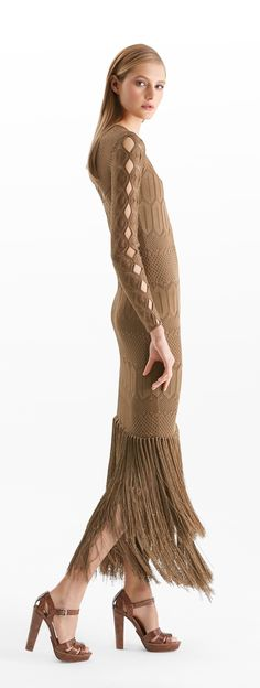 Intricate pointelle-knitting and two tiers of fringe at the ankle-grazing hem make this slim-fitting Ralph Lauren Collection silk dress a stunning choice for an evening event. Eye-catching cutouts along the sleeves and back accentuate its allure. Wear it with pared-down accessories.