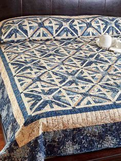 Our very own Angie Milligan (Graphic Designer at Fons & Porter) designed this stunning two-color quilt, Blue Me Away. It's a bed-size quilt pattern that is destined to impress! It's challenging, but well worth it.
