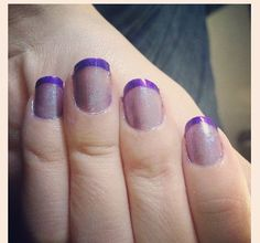 Purple tips with glitter on the nails that I did.