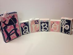 I painted these baby girl name blocks to match a nautical pink and navy nursery...