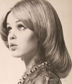 1969 glossy roll hairstyle