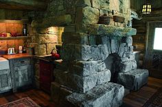 Fireplace beautifully seperates kitchen, living room, and probably bathroom. Cutthroat Cabin in Montana Rustic Fireplaces, Home Fireplace, Fireplace Kitchen, Cabin Homes, Log Homes, Big Sky Lodge, Ideas Para Organizar, Cabin Kitchens, Western Homes