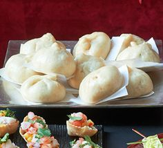 These fluffy steamed Chinese bites are filled with hoisin pork, perfect as part of a party buffet or canapé platter