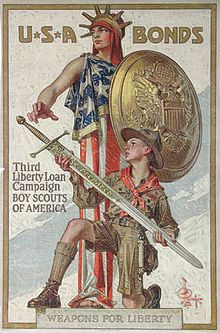 """""""Weapons for Liberty – U.S.A. Bonds."""" An appeal to youth to sell war bonds through in a scene of a Boy Scout lifting a sword toward Lady Liberty by Leyendecker"""