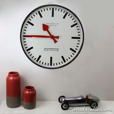 ELECTRIQUE CHROME CLOCK This handsome #retro  chrome wall #clock with bold red hands, is a real eye catcher. We love its Electrique logo. It's ideal for the kitchen, hallway or living room. #ANAHICollection #living #interiordesign #interiors