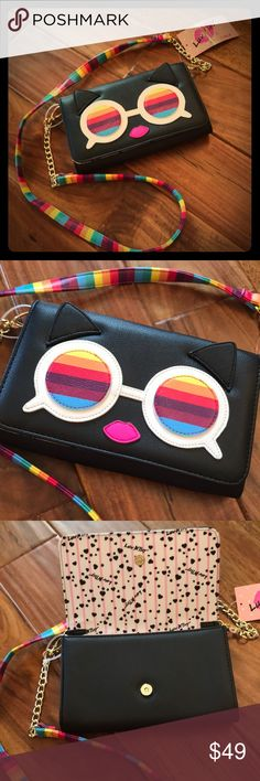 🆕 Betsey Johnson Rainbow Kitty Crossbody JUST IN‼️-  This adorable, colorful Kitty Betsey Johnson Crossbody has a removable strap!  Interior is fully lined and has two compartments separated by a zippered pocket.  (My iPhone 7+ easily fits in the pockets.   There are also four slip pockets in the bag to hold your IDs and cards.  💋Every gal needs a Betsey!💋 Betsey Johnson Bags Crossbody Bags