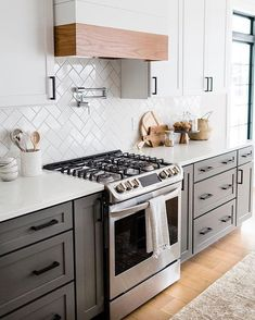 A contemporary wall mounted pot filler brings an immediate wow-factor and an air of luxury to this kitchen from Does… Kitchen Reno, Kitchen Cabinets, Kitchen Ideas, Light Gray Cabinets, Unique Tile, All White Kitchen, Delta Faucets, Stone Houses, Updated Kitchen