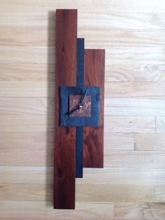 Clock. Upcycled hardwood flooring, Shou Sugi Ban (charred) cedar. From the studio of JulieAnne Hage. St. Albert, Albert, Canada