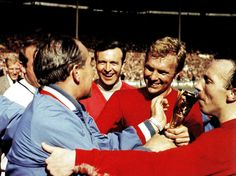 Nobby Stiles kisses the treasured World Cup trophy as Bobby Moore (C) is congratulated by England manager Alf Ramsey (in blue) at Wembley Stadium - UK - 30 July 1966 England National Football Team, England Football, National Football Teams, England International, International Football, Jules Rimet Trophy, 1966 World Cup Final, World Cup Trophy, Soccer